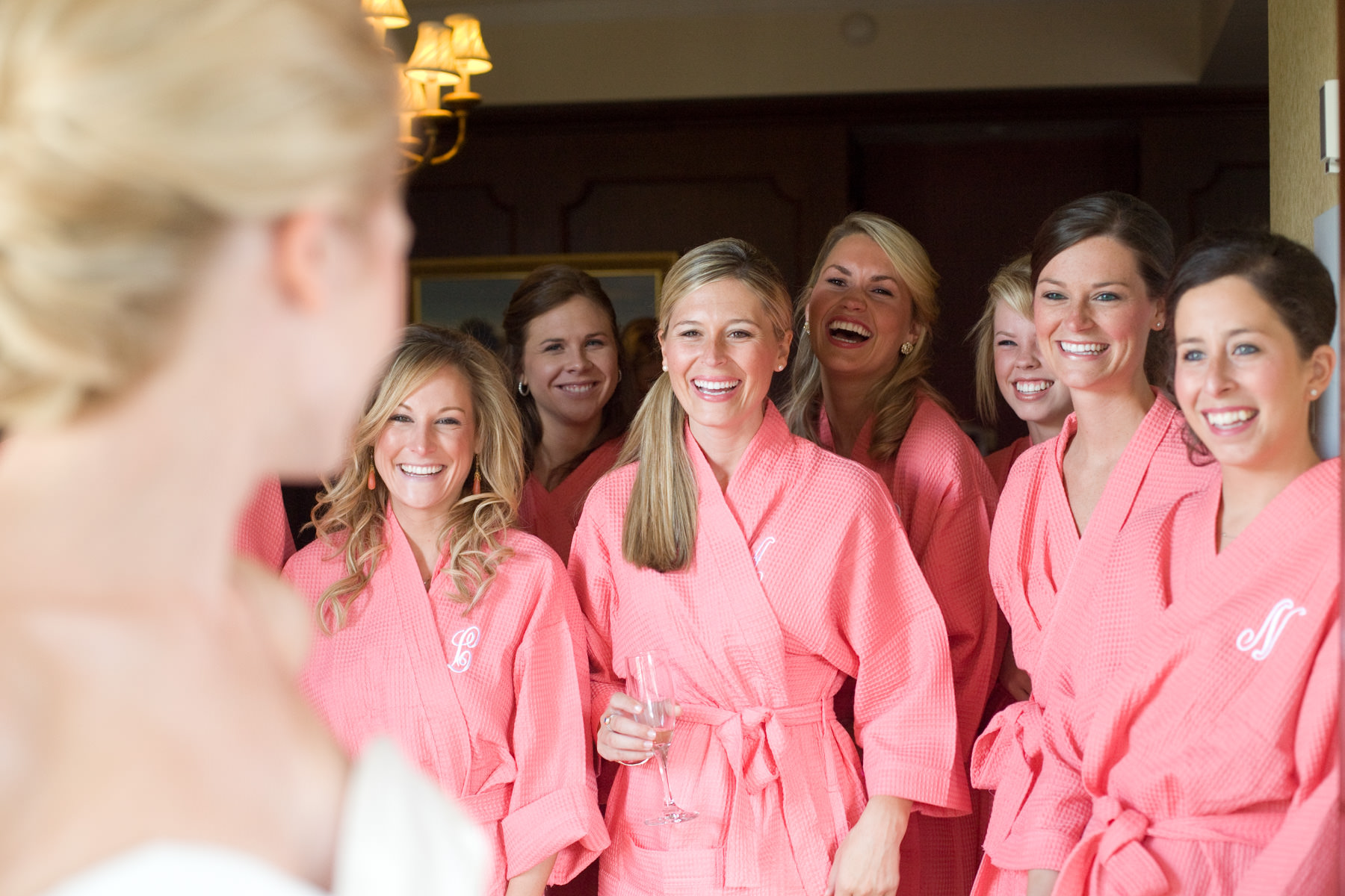 Bridesmaids in monogrammed bathrobes in the bridal suite at The Broadmoor.