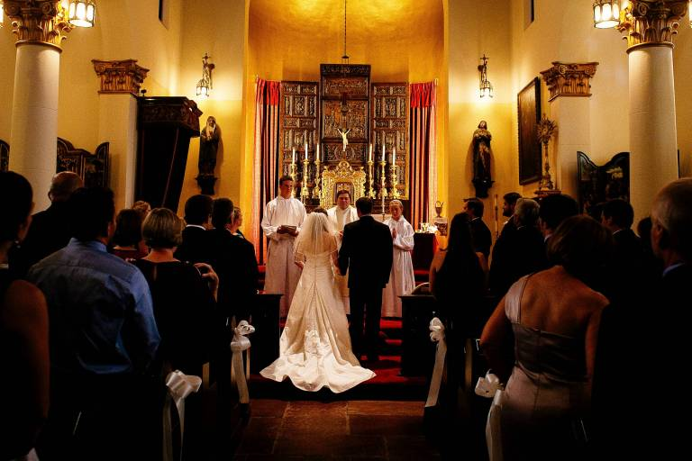 Bride and groom at the altar during their wedding ceremony at the Pauline Chapel.