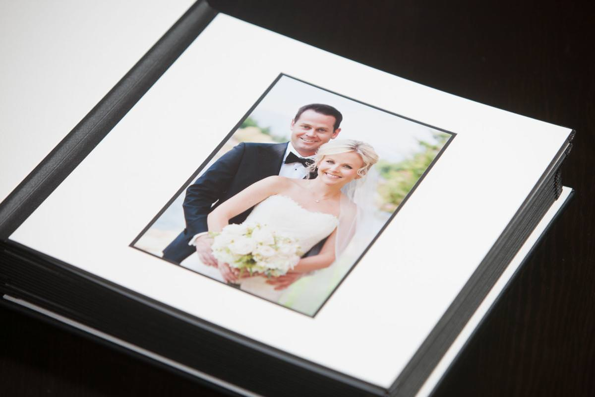 Matted wedding album with picture of couple.