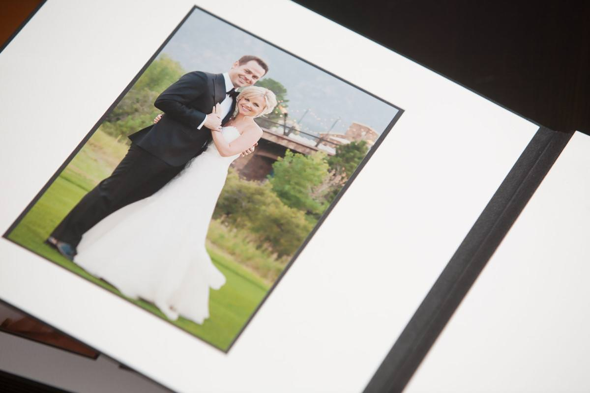Matted wedding album with wedding pictures inset.