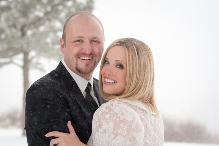 Bride and groom portrait in the snow at the Garden of the Gods Club