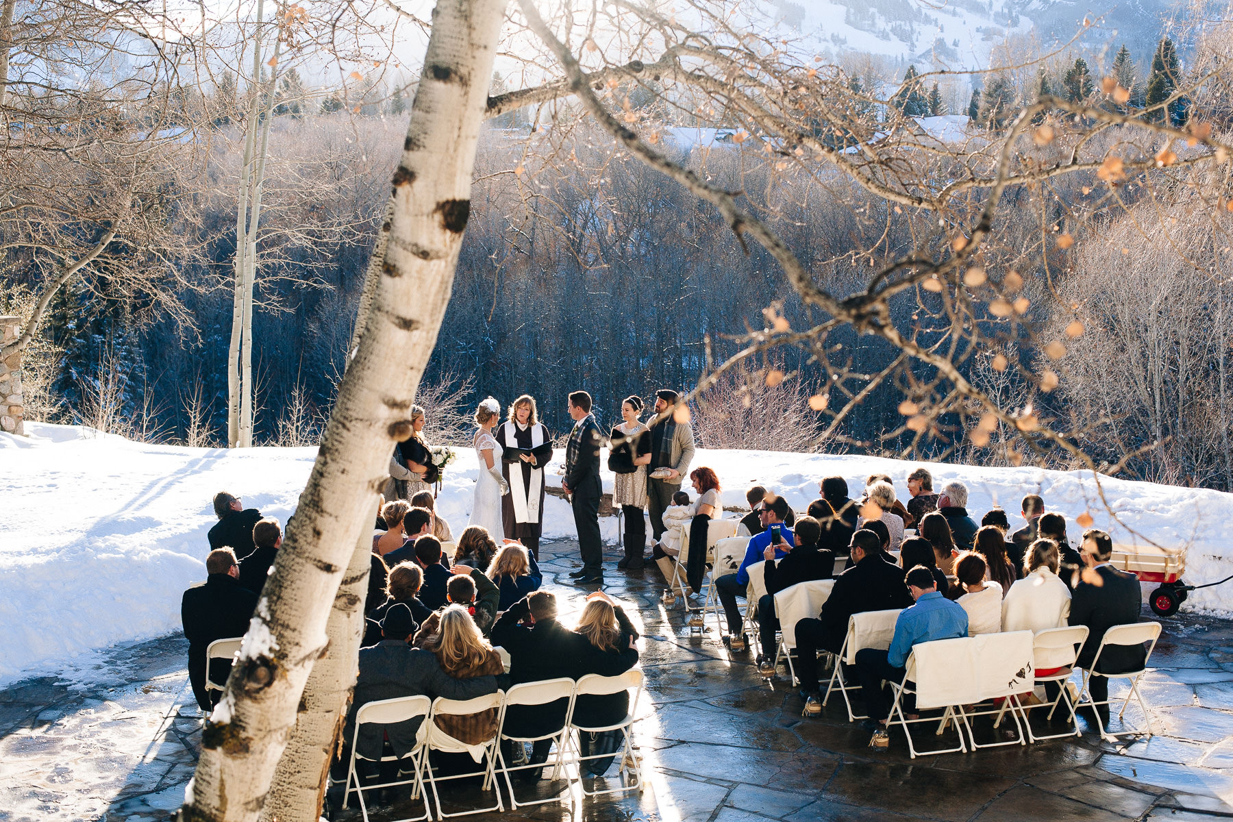 Winter wedding ceremony with snow and aspens at Aspen Meadows Resort in Aspen, Colorado.