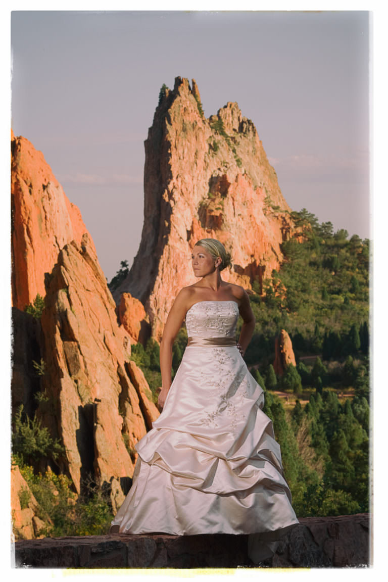 Bride in wedding dress at sunset at Garden of the Gods