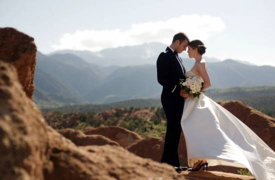 Bride and groom embrace each other at the Garden of the Gods in Colorado Springs, Colorado.