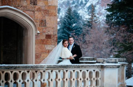 Wedding couple on veranda at the Glen Eyrie Castle.