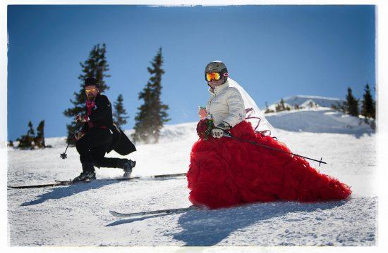 Bride and groom skiing together at Loveland Ski Area
