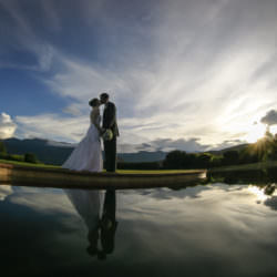 Bride and groom kiss at sunset in front of the reflection pool at the Garden of the Gods Club.