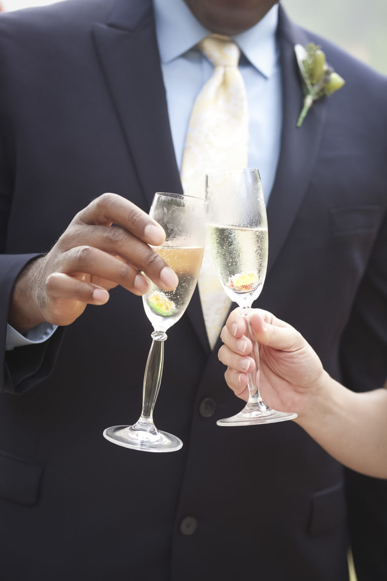 Bride and groom toasting with champagne.