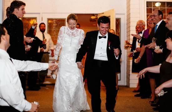 Wedding couple exits Cheyenne Mountain Country Club.