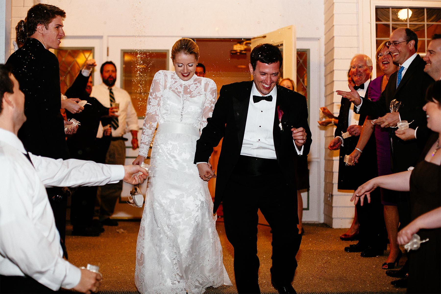 Wedding couple exits Cheyenne Mountain Country Club.