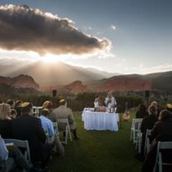 Bar Mitzvah ceremony at sunset with Garden of the Gods park and Pikes Peak.