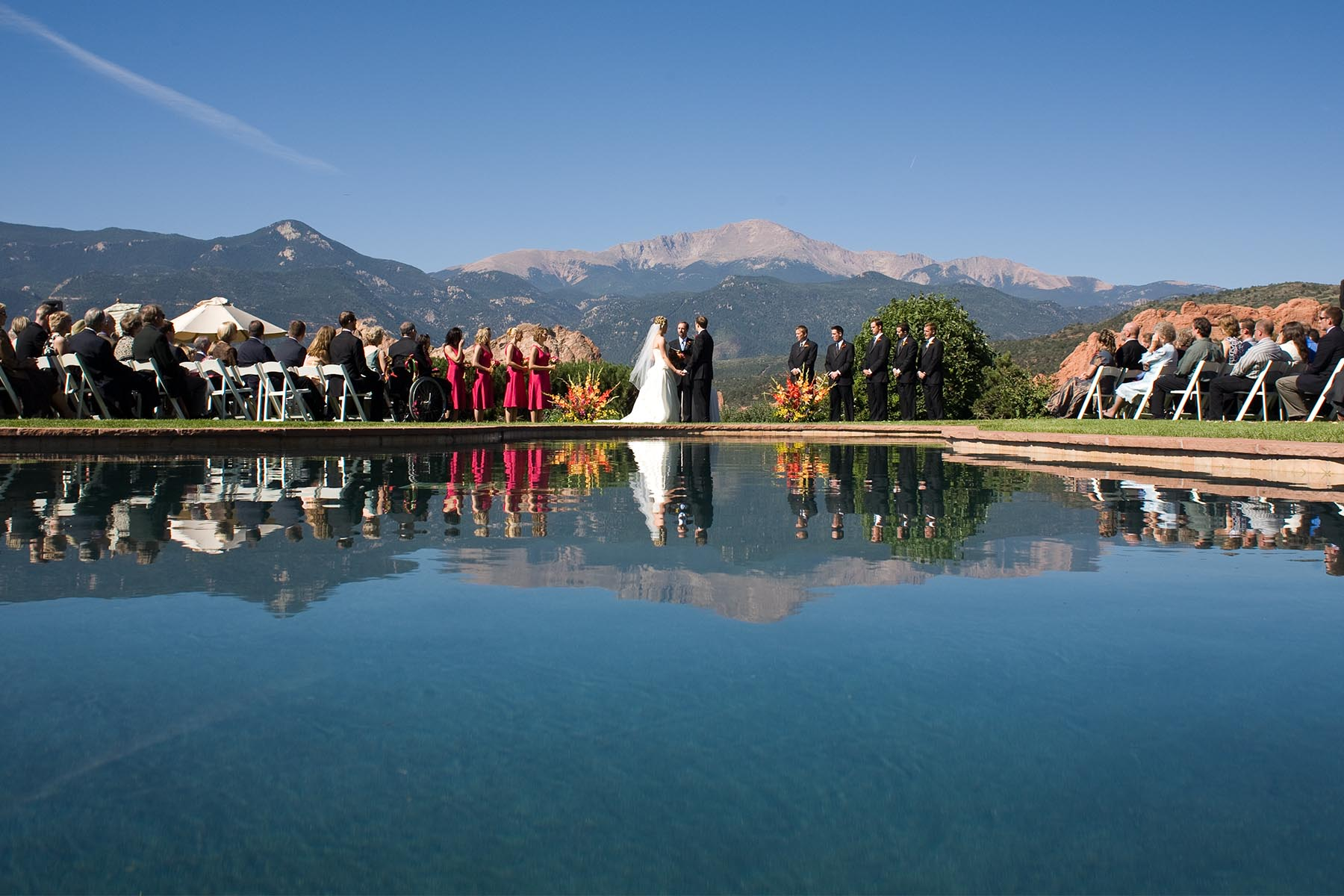 Wedding ceremony in front of the reflection pool at the Garden of the Gods Club.