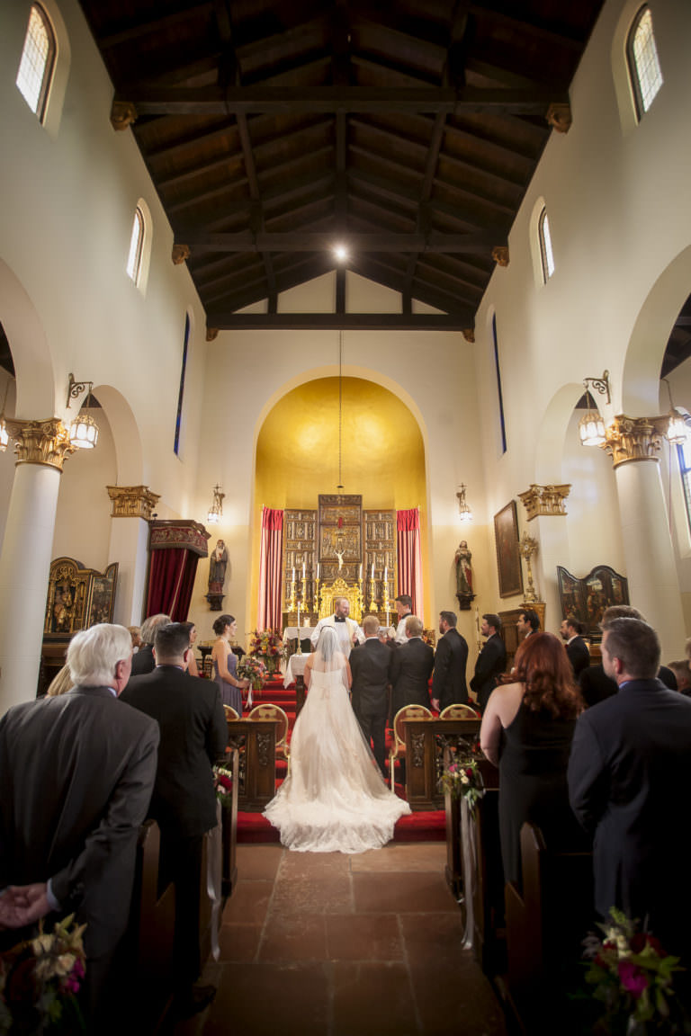 Bride and groom at altar during wedding ceremony inside Pauline Memorial Chapel.