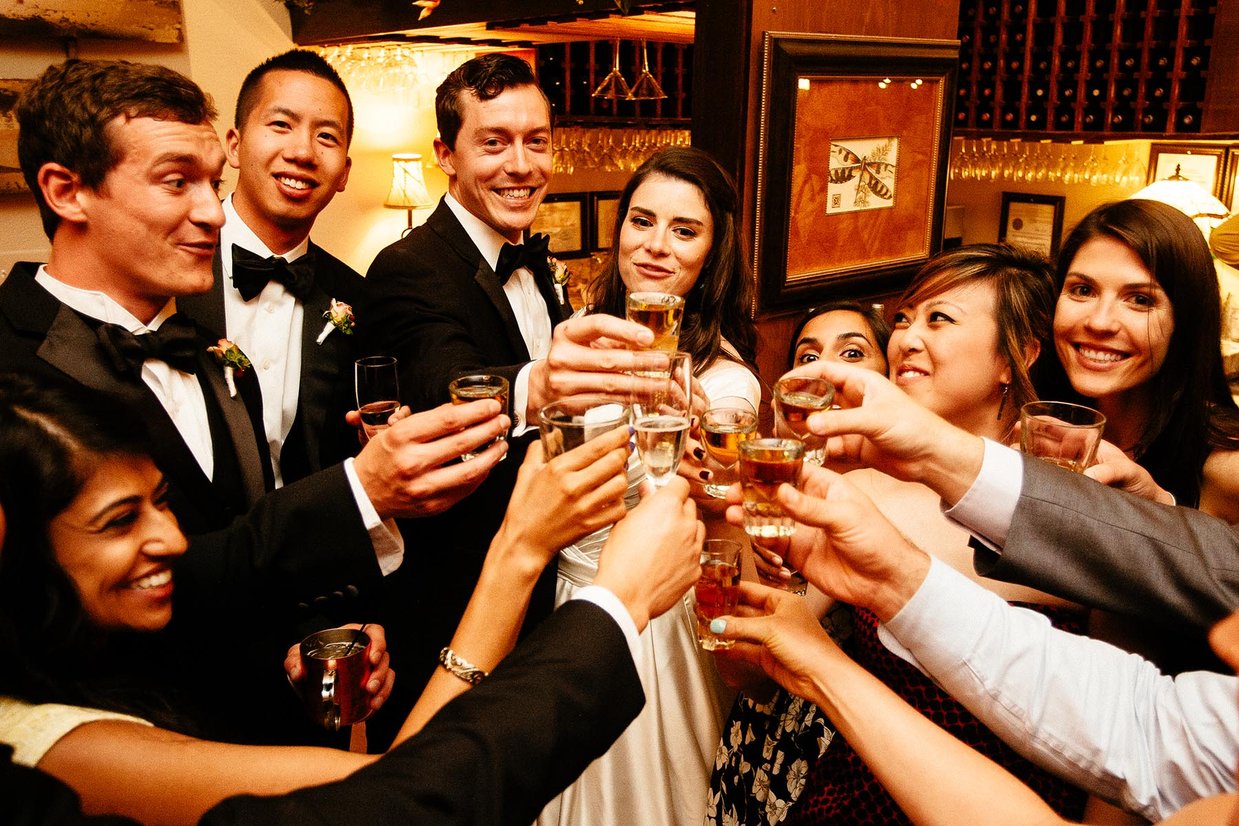 Wedding couples shares a toast with their guests at the Craftwood Inn.
