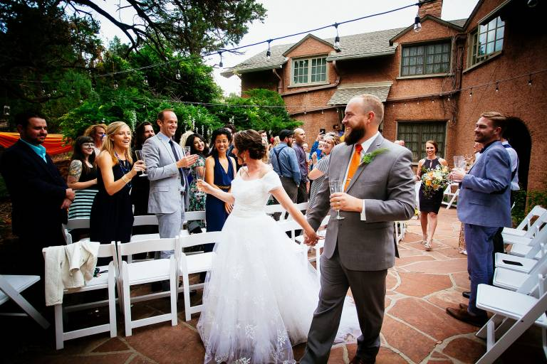 Couple greets guests on the patio after their wedding ceremony at SunMountain Center