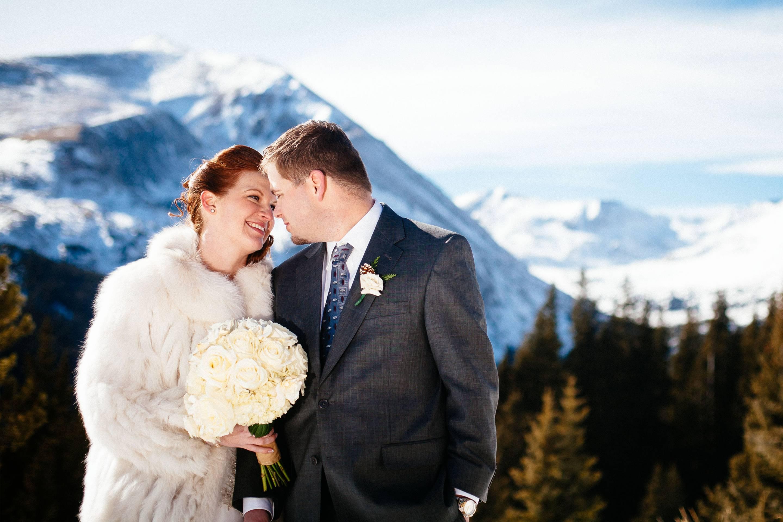 Wedding couple embrace on Hoosier Pass.