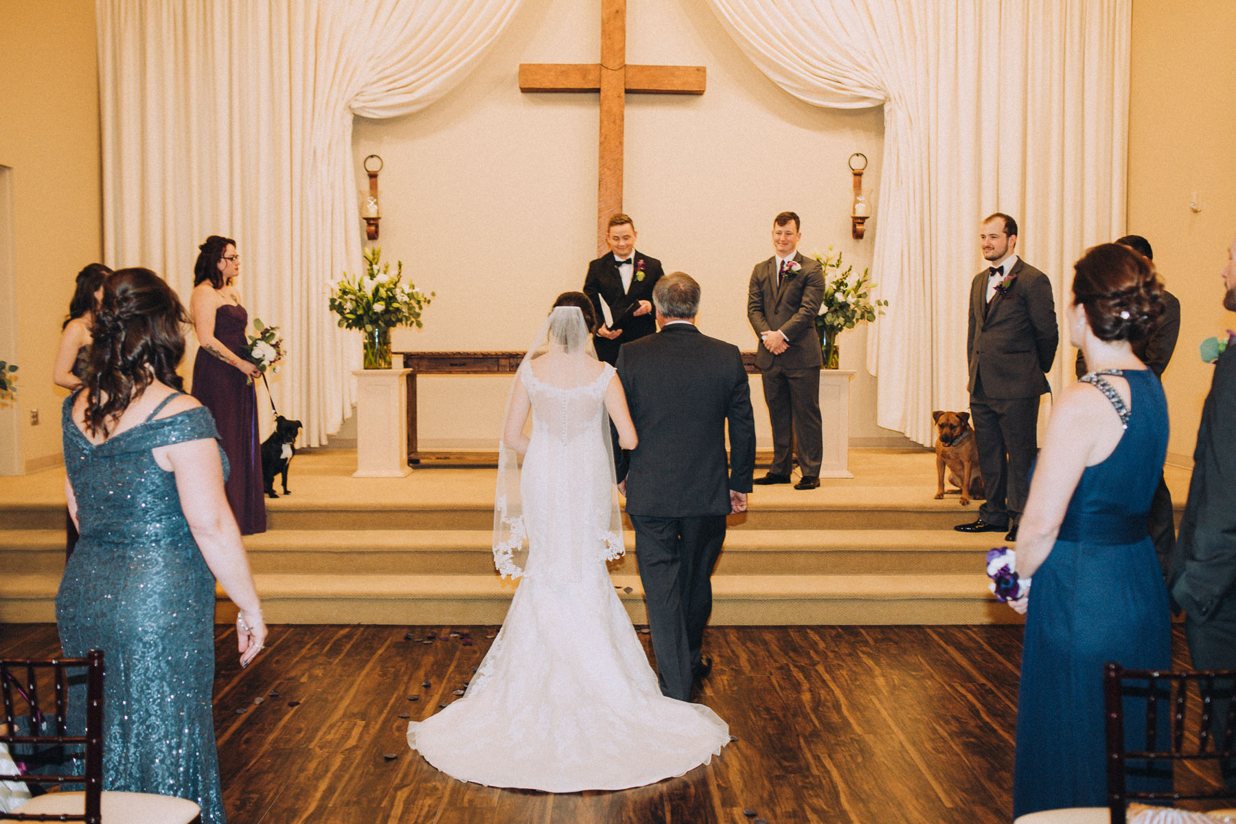 Bride approaches the altar with her father at the Wedgewood Black Forest.
