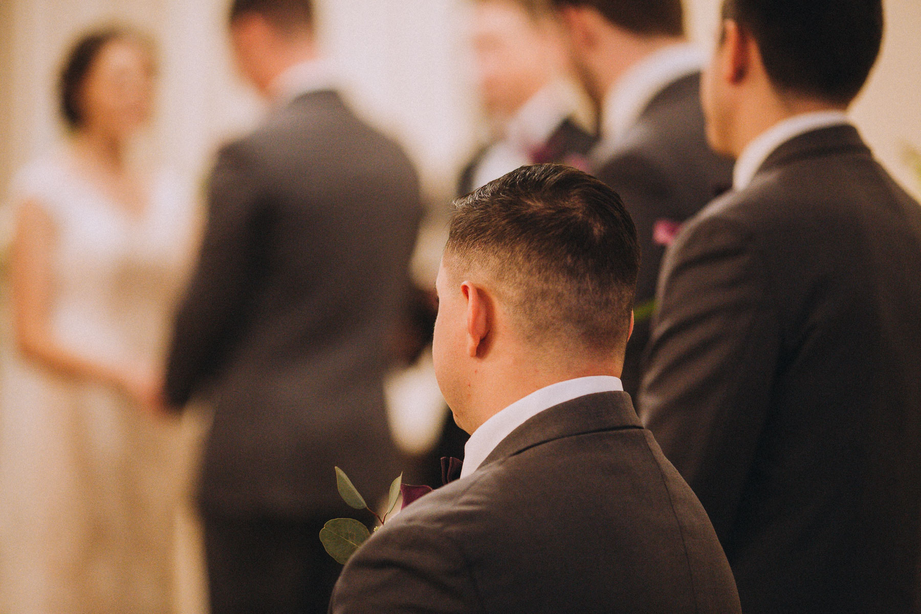 Groomsman looking on during wedding ceremony at Wedgewood Black Forest.