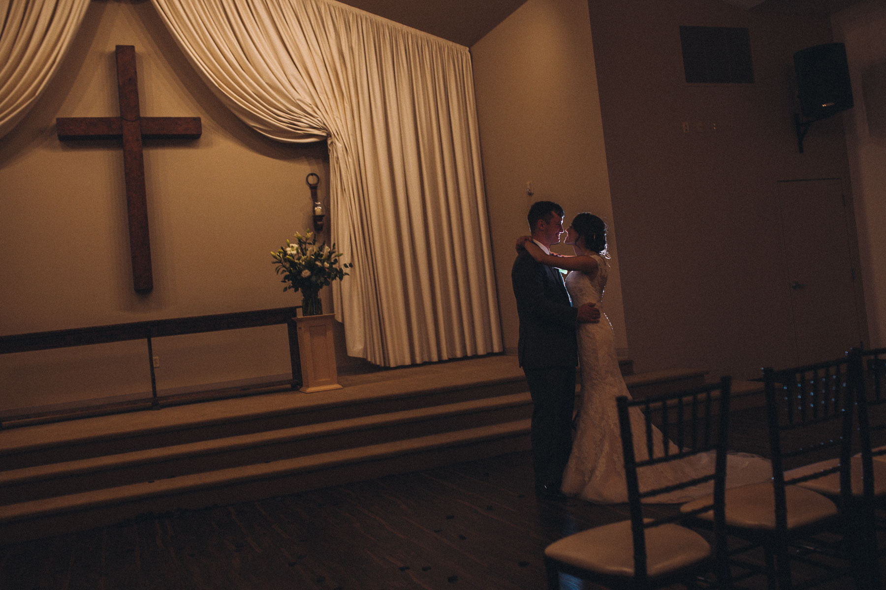 Bride and groom embrace inside the chapel at Wedgewood Black Forest.