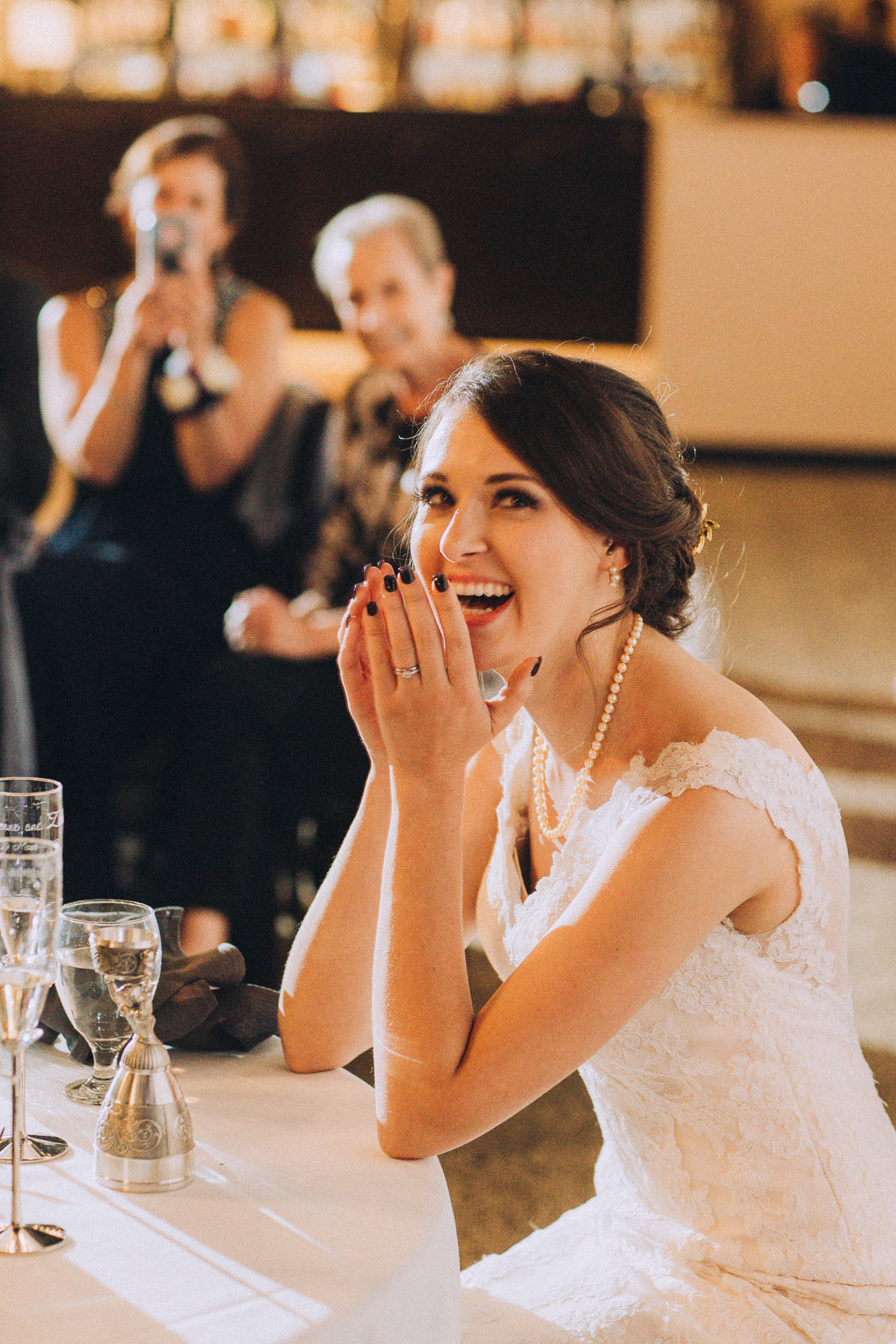 Bride laughs during wedding reception at Wedgewood Black Forest.