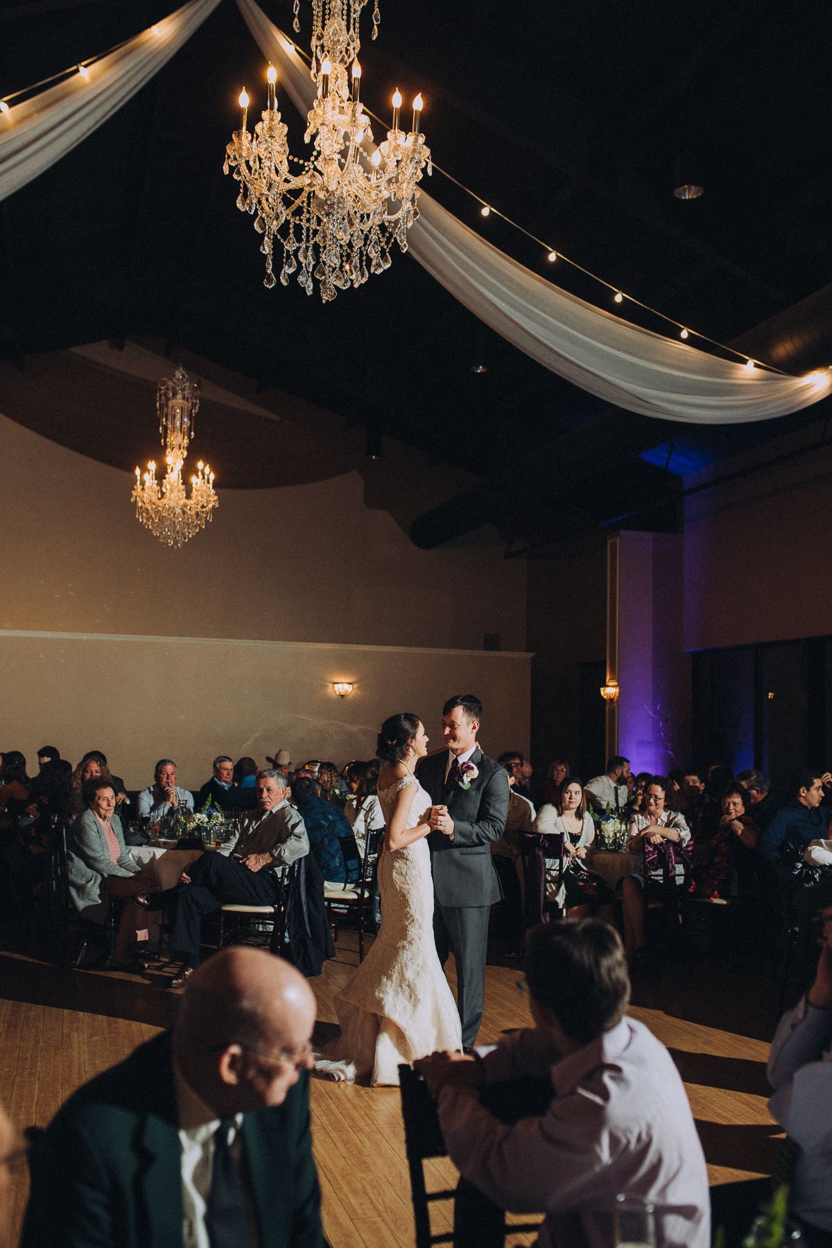 Bride and groom dance underneath chandelier at the Wedgewood Black Forest
