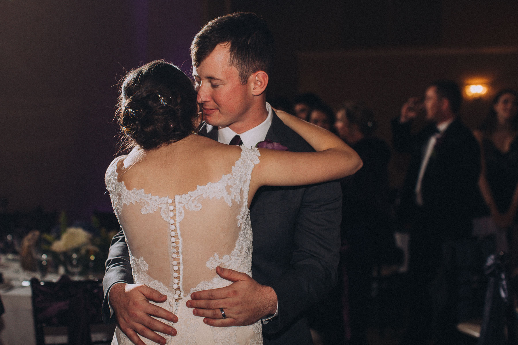 Groom holds bride during dance at Wedgewood Black Forest.