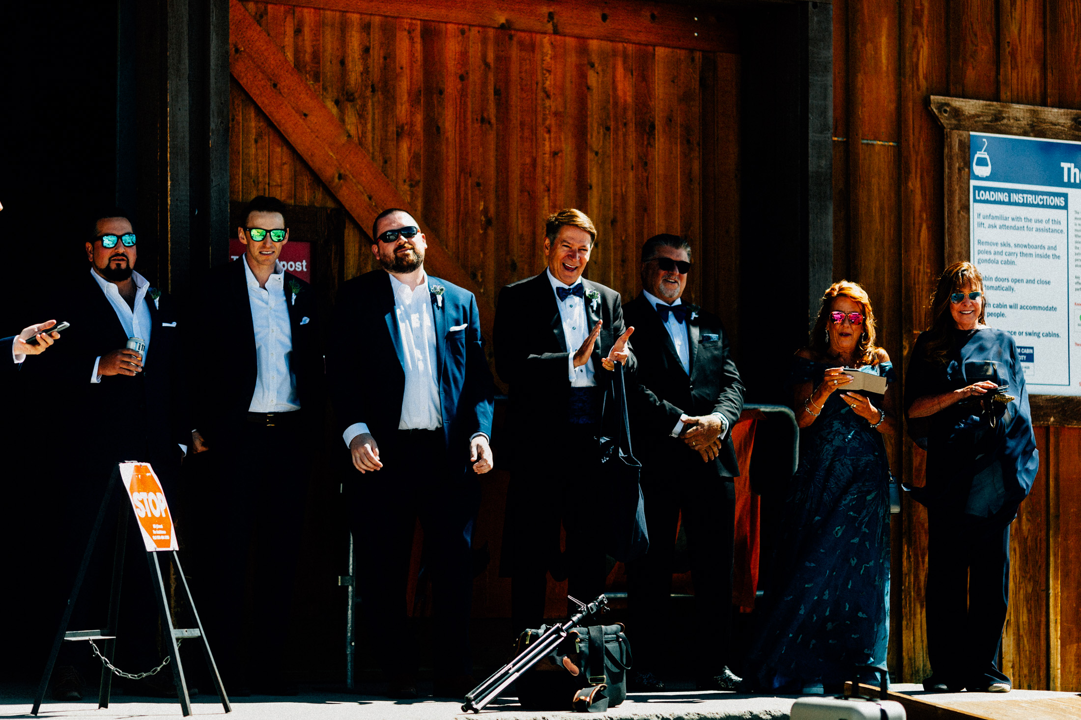Wedding party at the top of Keystone Resort watches as bride and groom see each other.