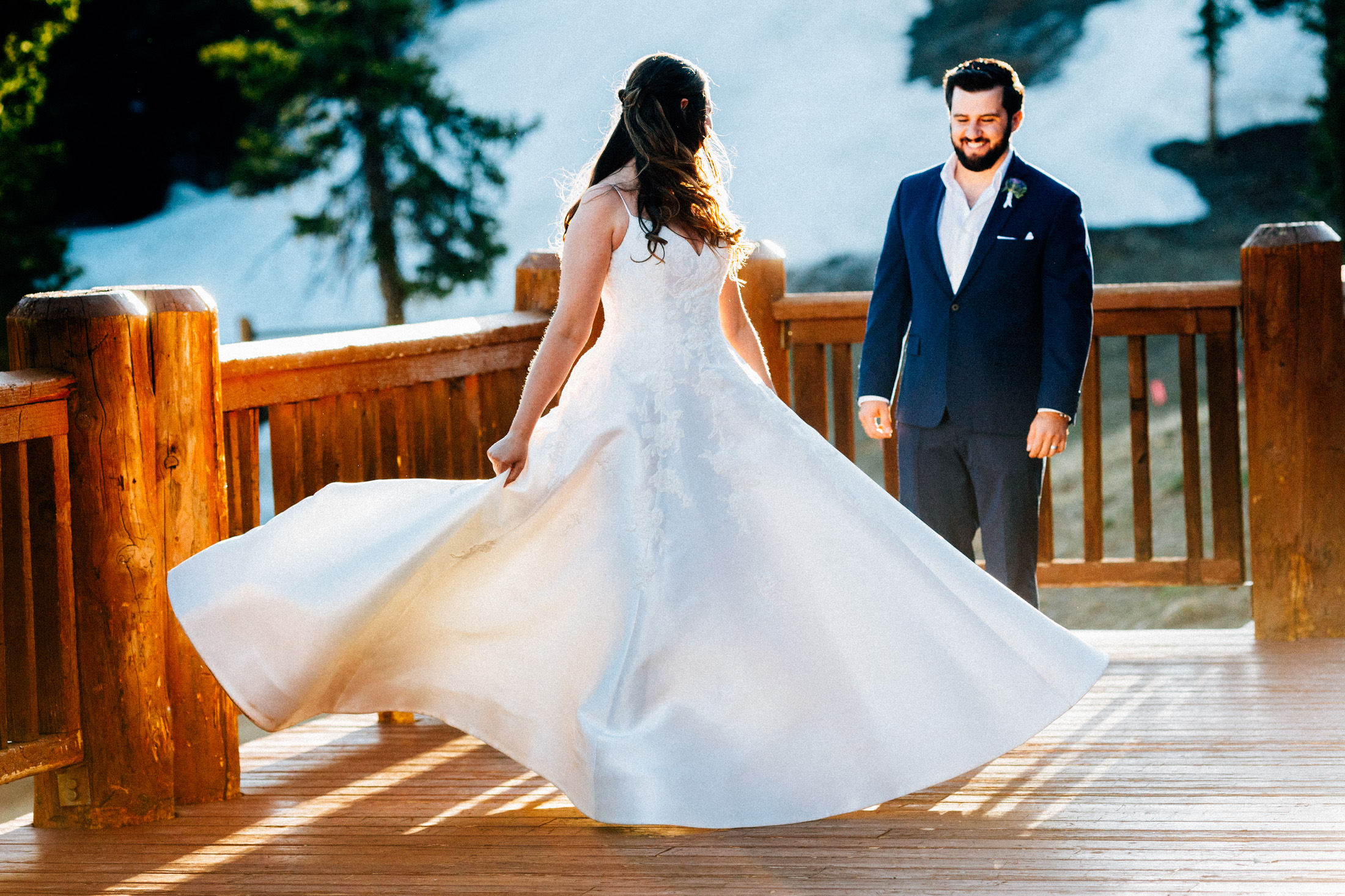 Bride twirls her dress for the groom on the deck at Timber Ridge Lodge.