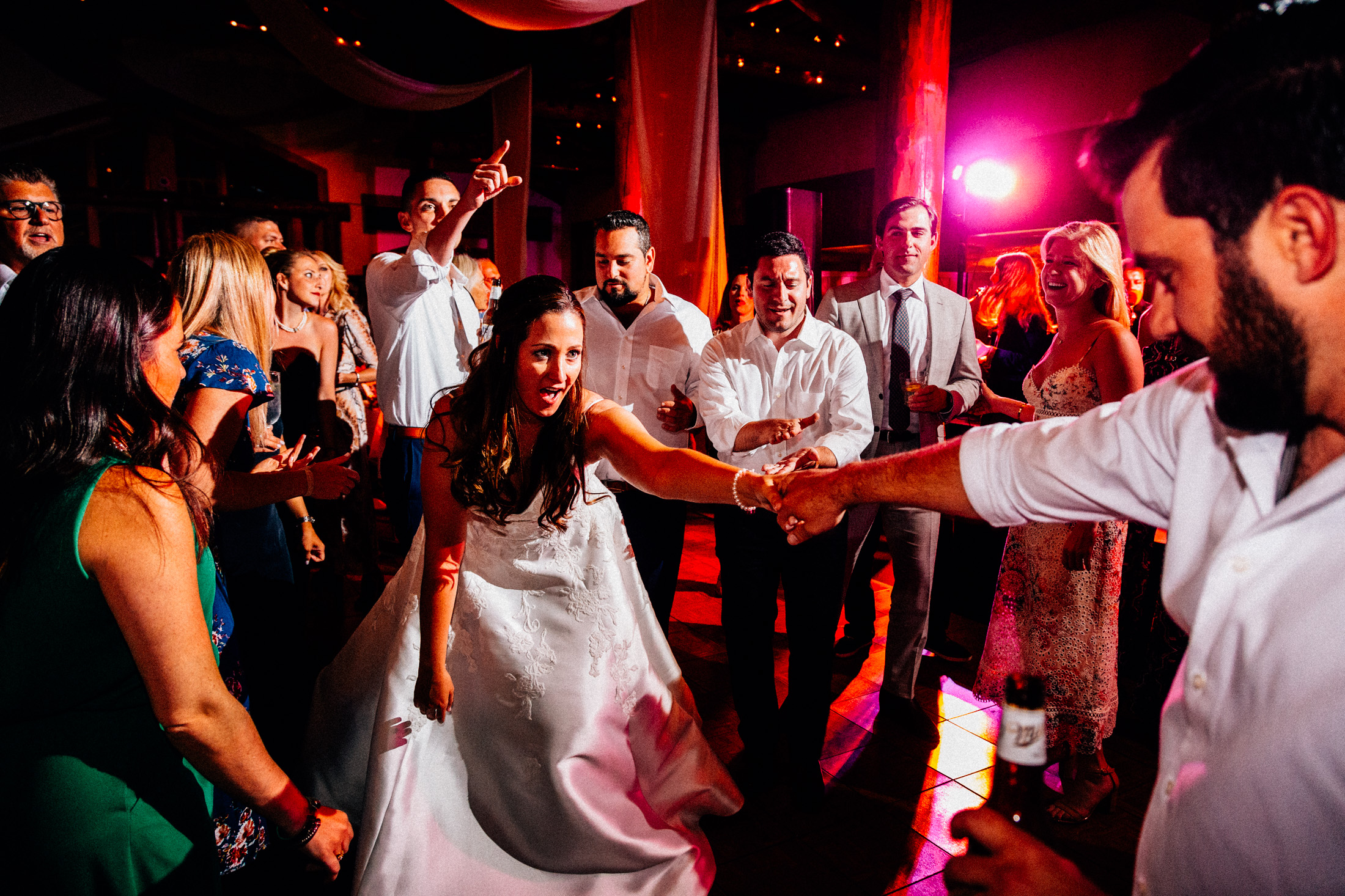 Bride dances with groom during wedding reception inside Timber Ridge Lodge.