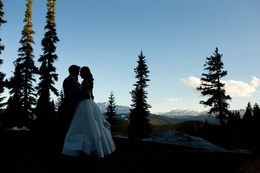 Couple embraces at timberline at Keyston Resort.