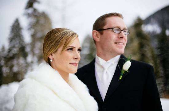 Wedding couple in the winter snow at Ski Tip Lodge.