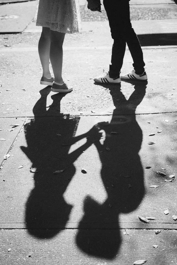 Shadow of two people holding hands.