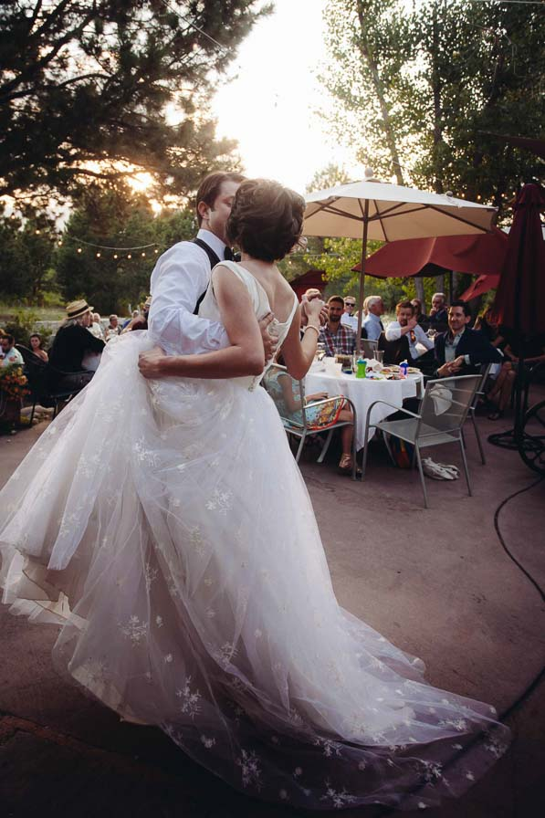 Couple's first dance outside on patio.