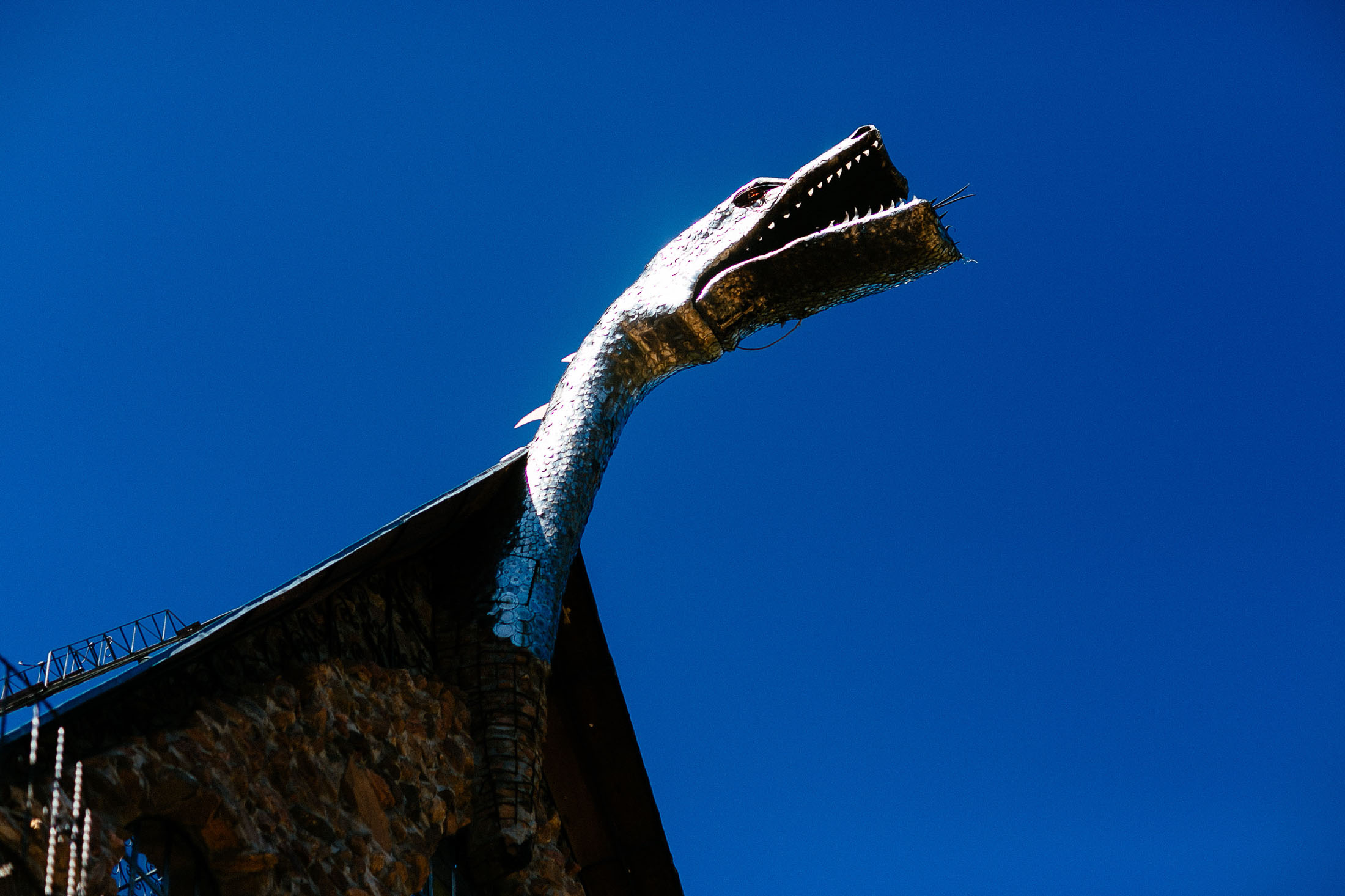 Photo of steel dragon atop Bishop Castle.