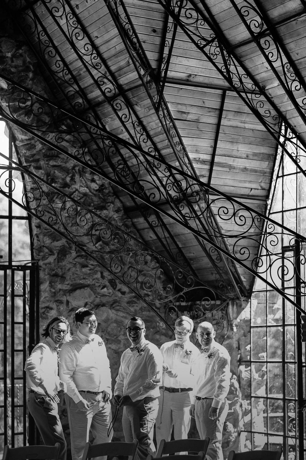 Black and white photo of groomsmen waiting for ceremony to start inside Bishop Castle.