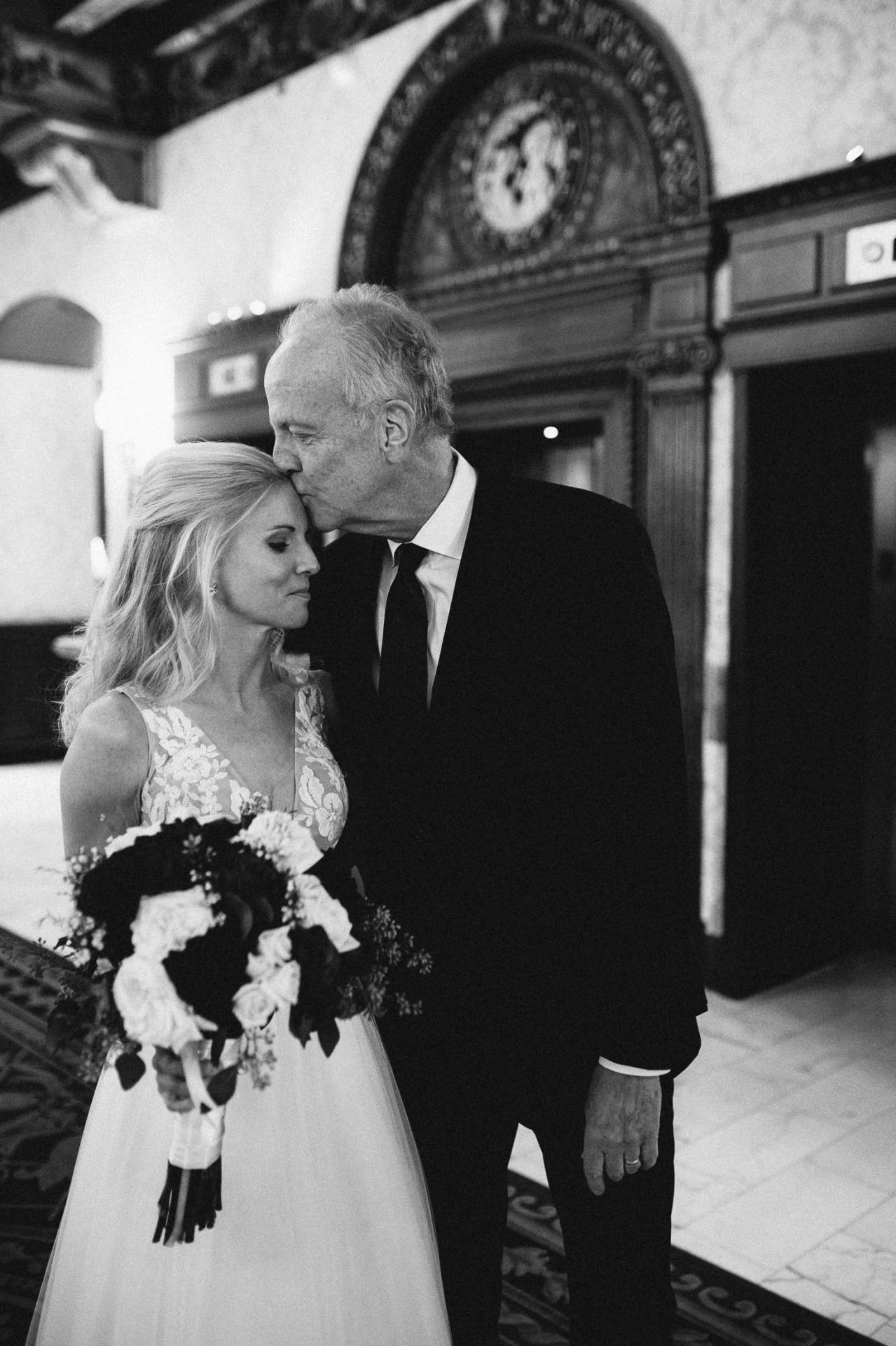 Black and white picture of father of the bride seeing daughter for the first time.