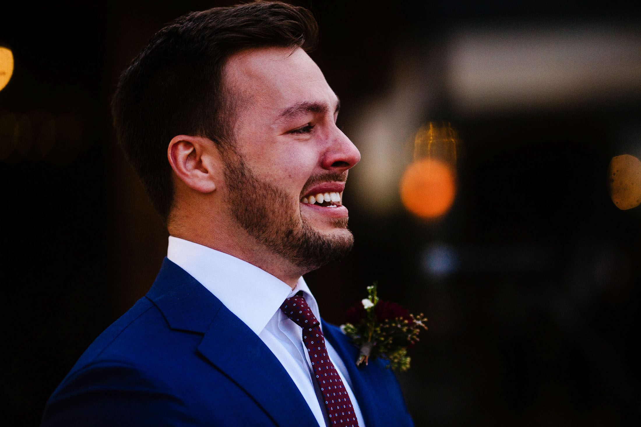 Close-up of groom cyring when he sees bride for the first time during wedding ceremony.
