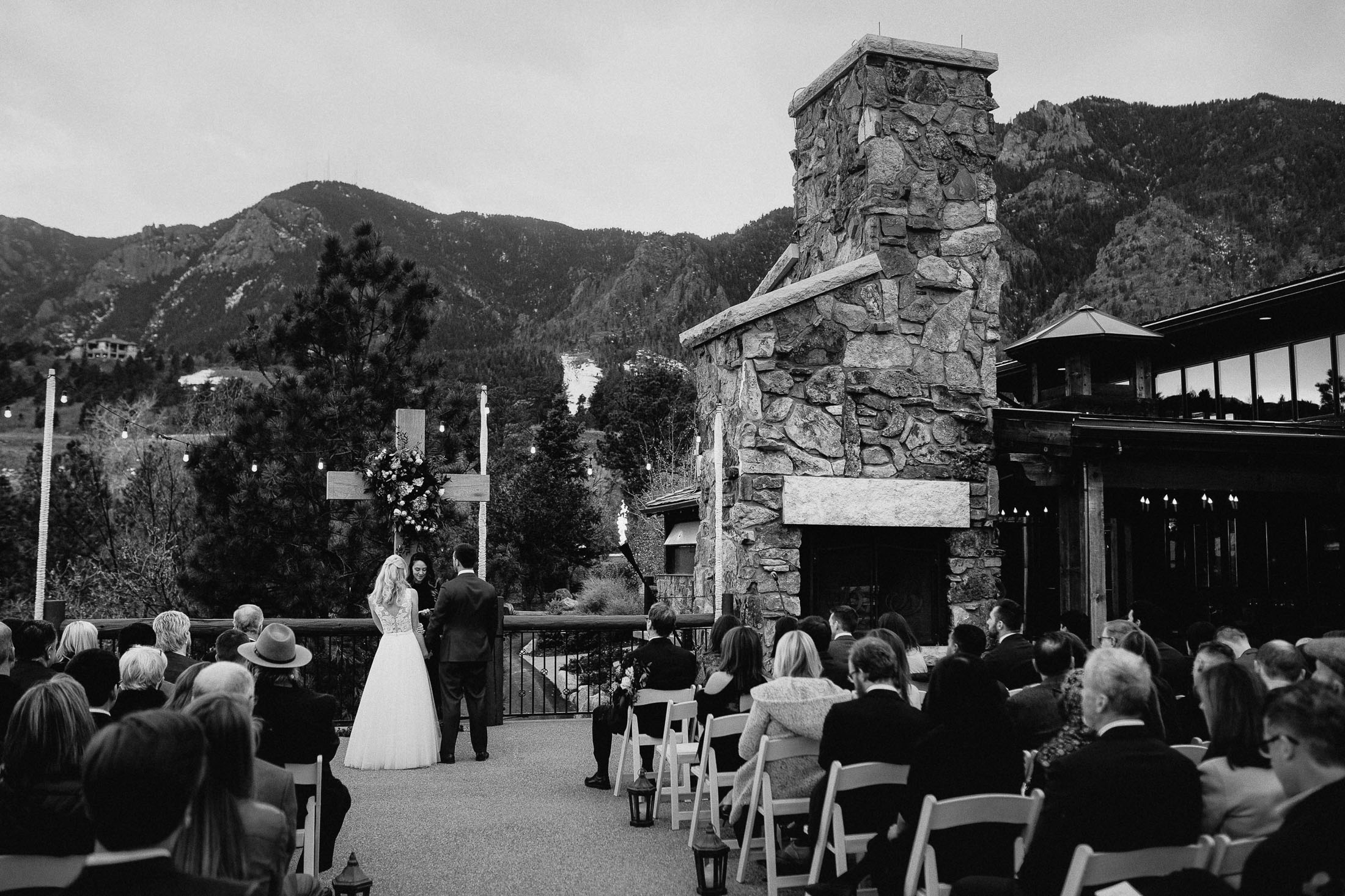 Black and white photograph of bride and groom standing at the altar during outdoor wedding ceremony at the Cheyenne Lodge.