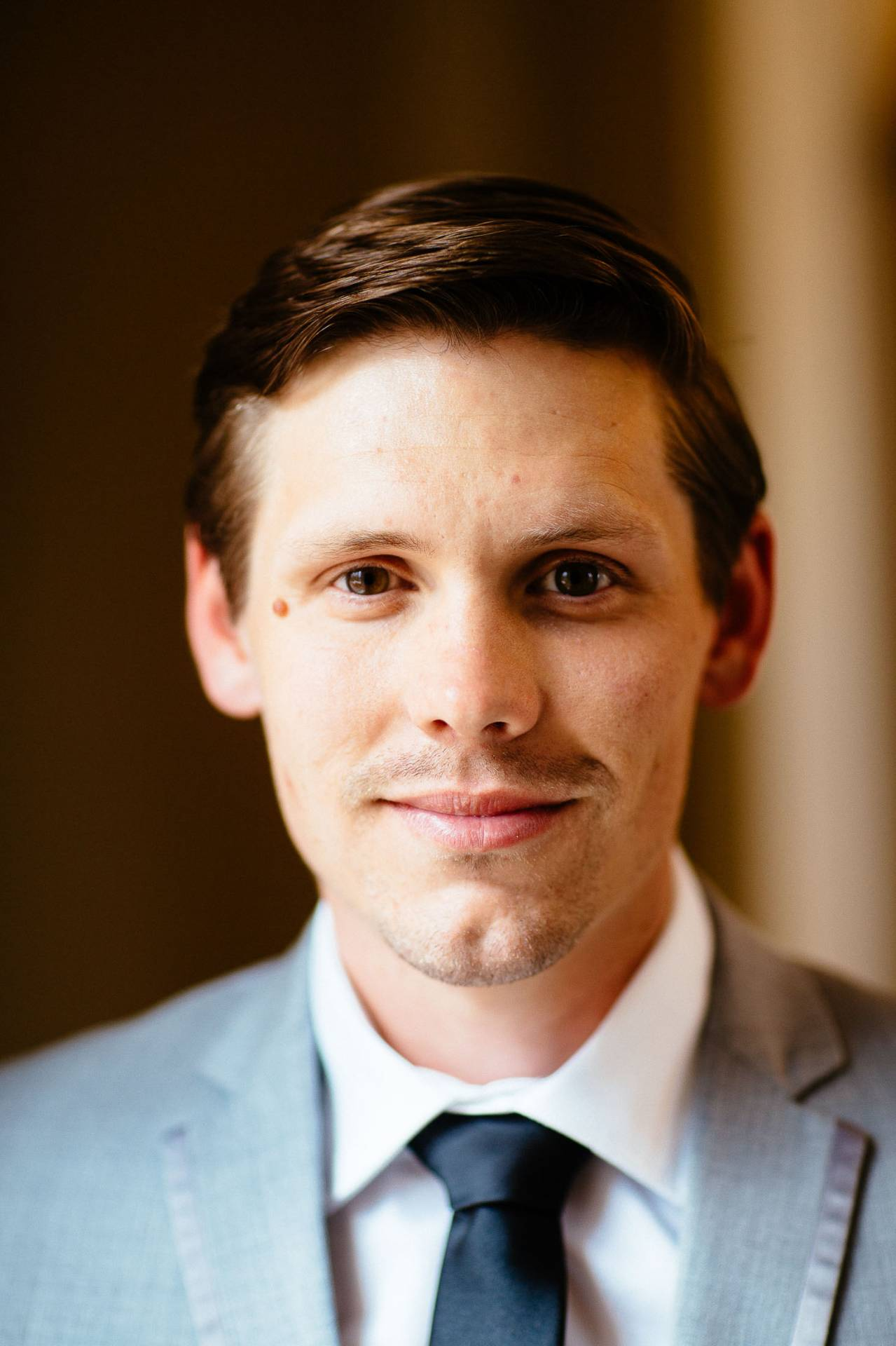 Portrait of groom on his wedding day at The Broadmoor.