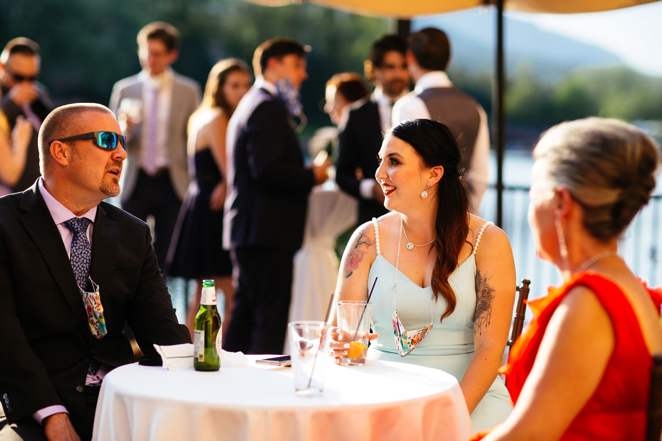 Guests on the patio at the South Tower during wedding reception.
