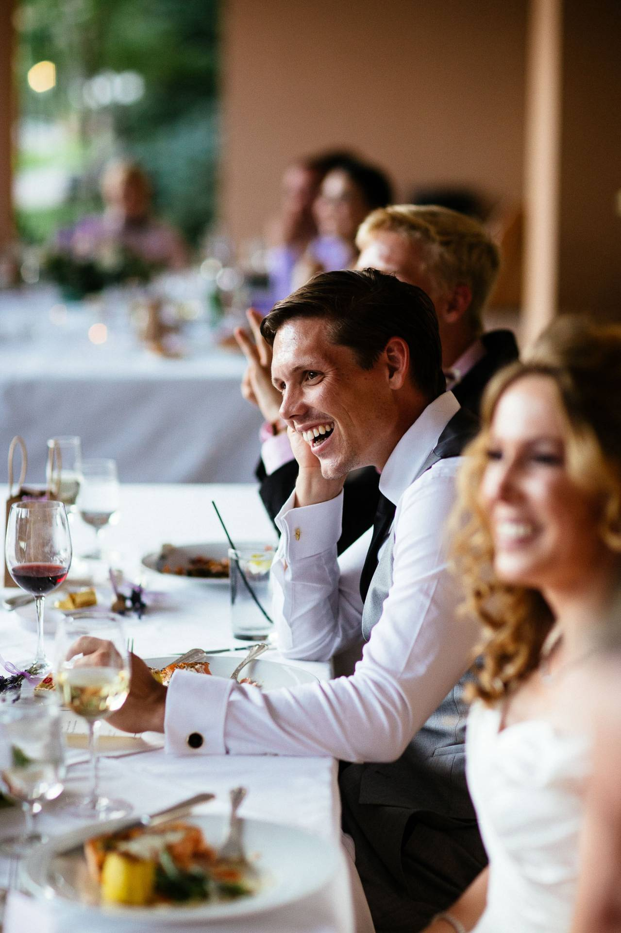 Groom laughs during toasts at the wedding reception at The Broadmoor.