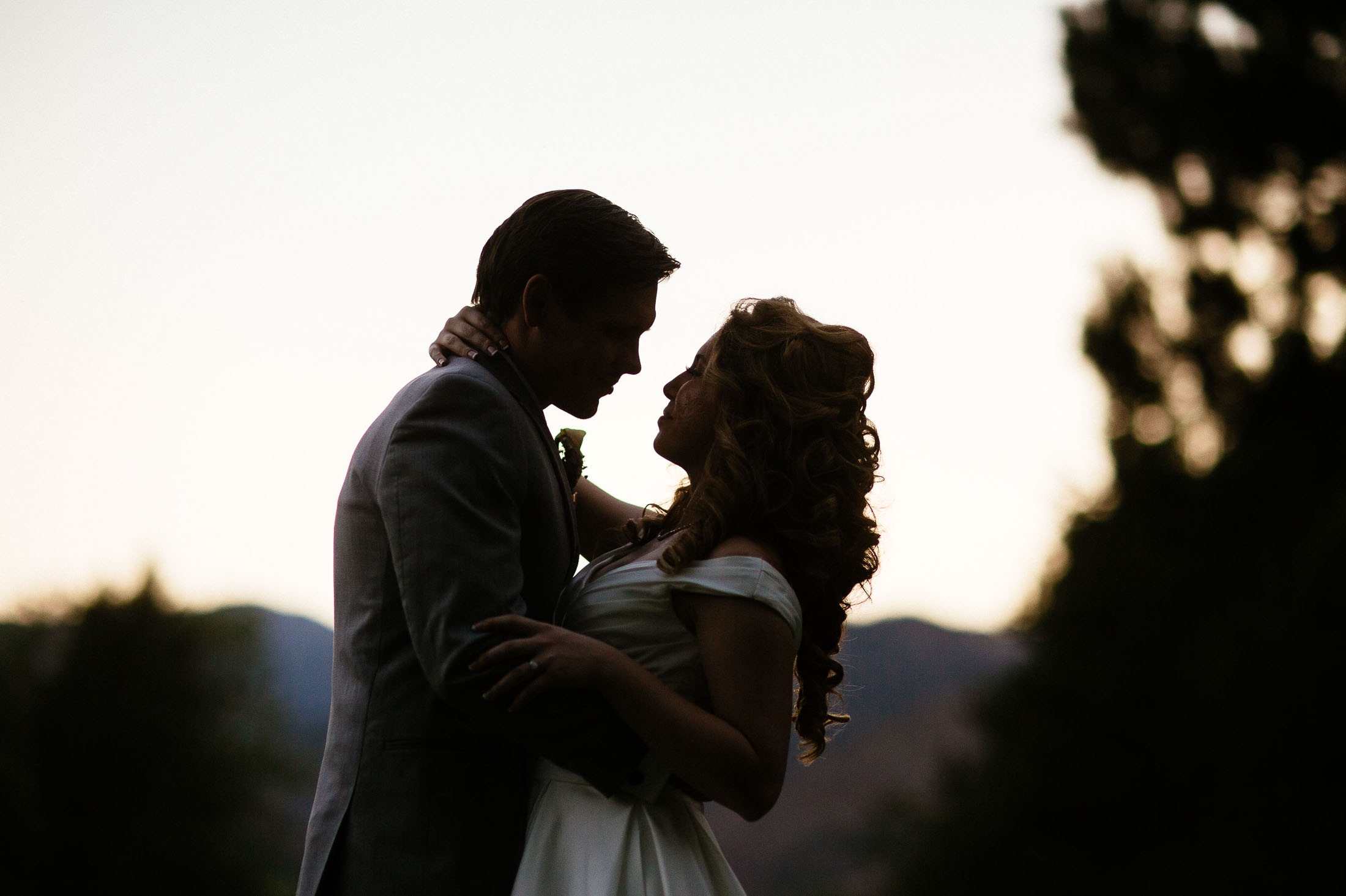 Bride and groom embrace at sunset on their wedding day at The Broadmoor.